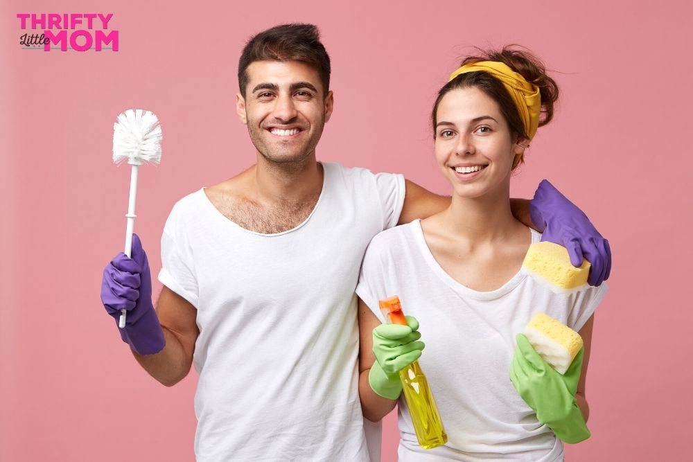 Couple with cleaning products