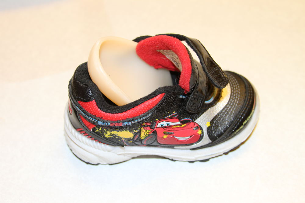 This is how you insert the hard plastic orthotic into the shoe.