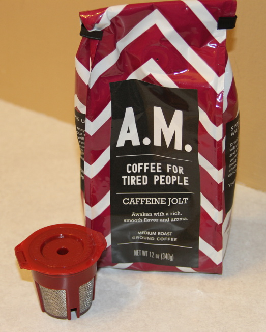 Buy a re-usable coffee pod and fill it with your own favorite coffee.