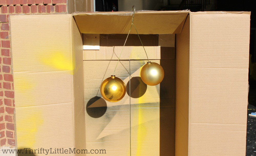 Spray Paint Ornaments In Cardboard Box