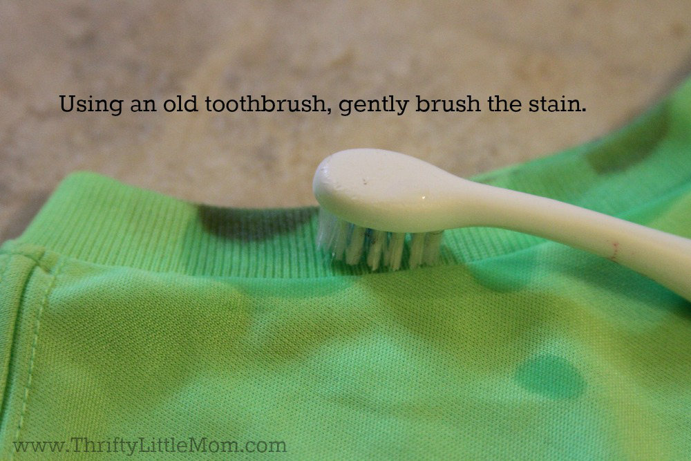Using a toothbrush pretreat the stain