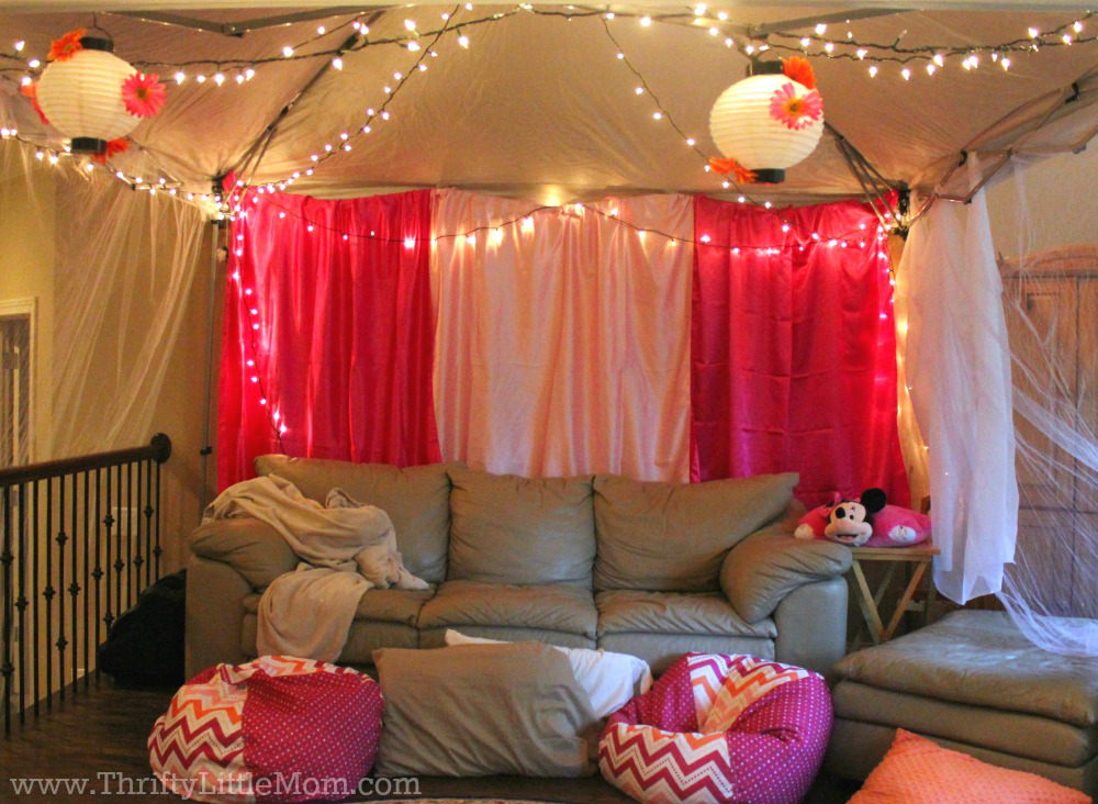 couch with lights draped for indoor movie party 5th birthday