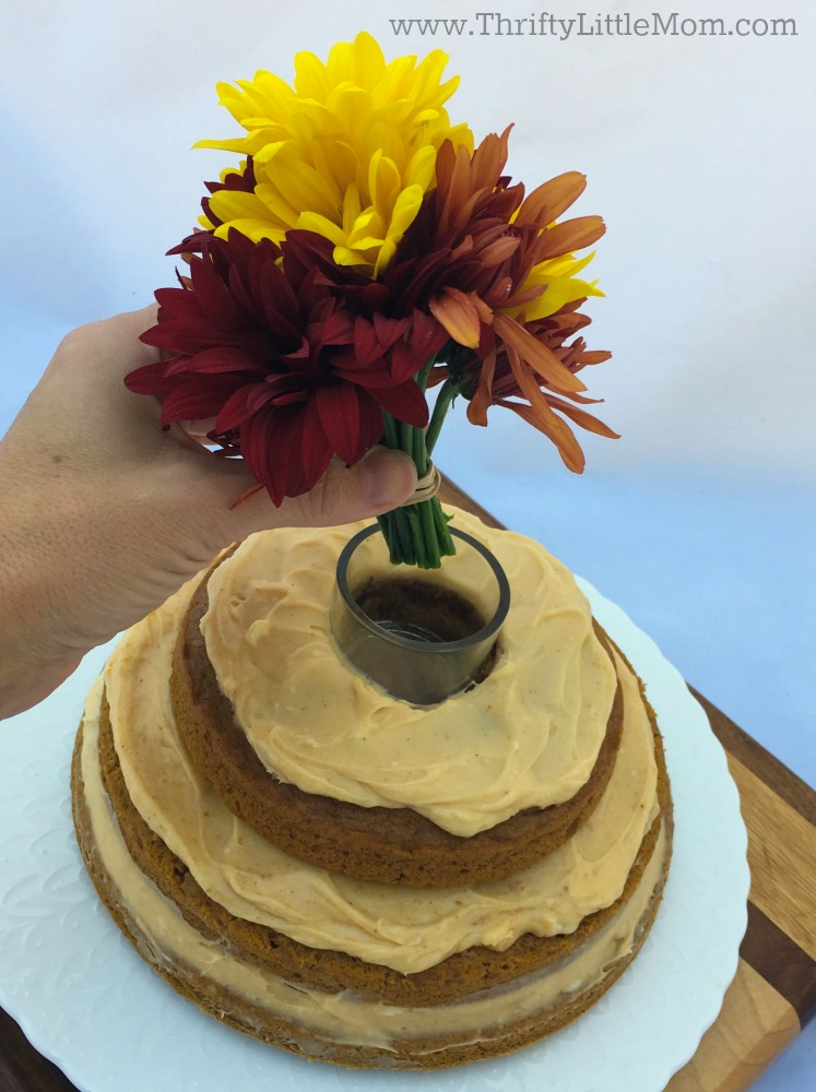 adding-flowers-to-a-naked-cake
