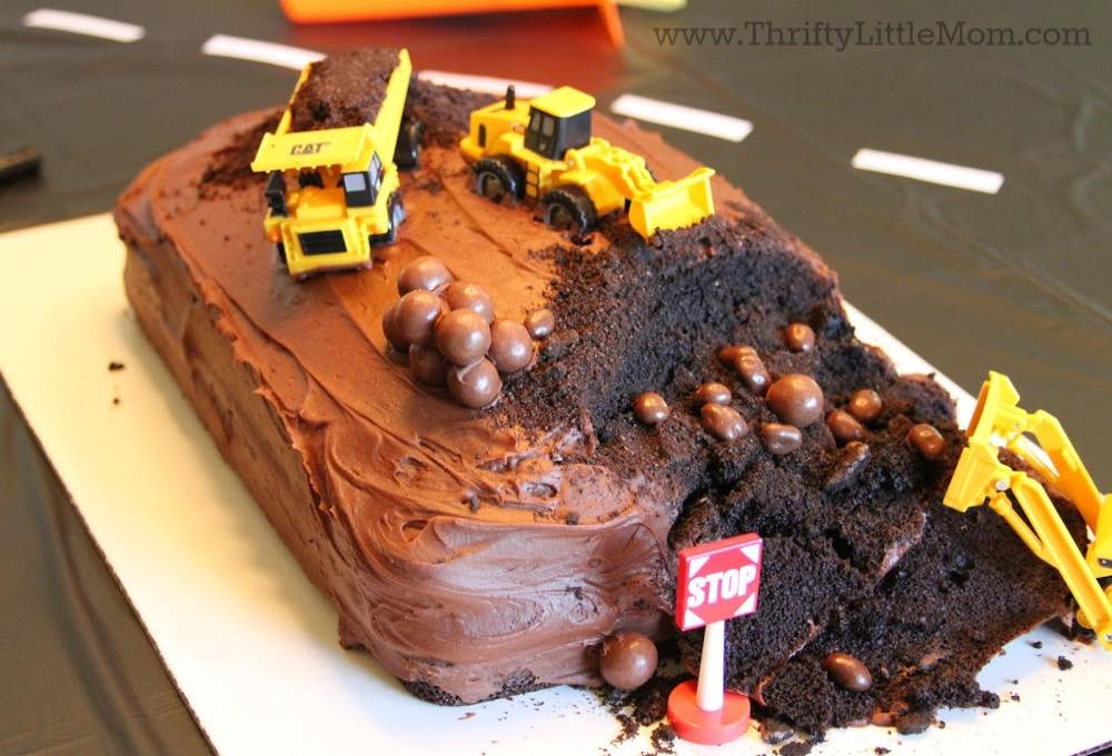 construction trucks on cake for 5th birthday party