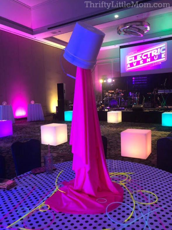 Paint bucket spill table centerpiece for 80's party