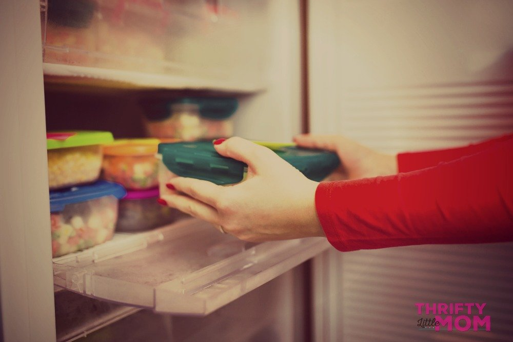 Woman Placing Party Food in Fridge