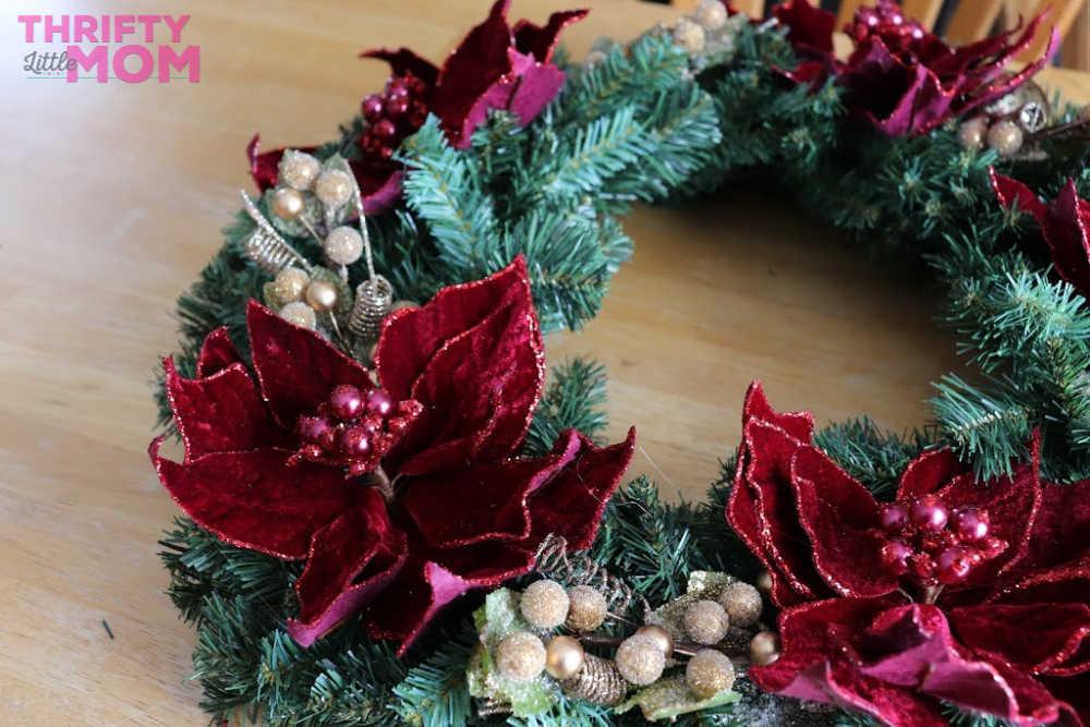 placing decor on poinsettia decor wreath