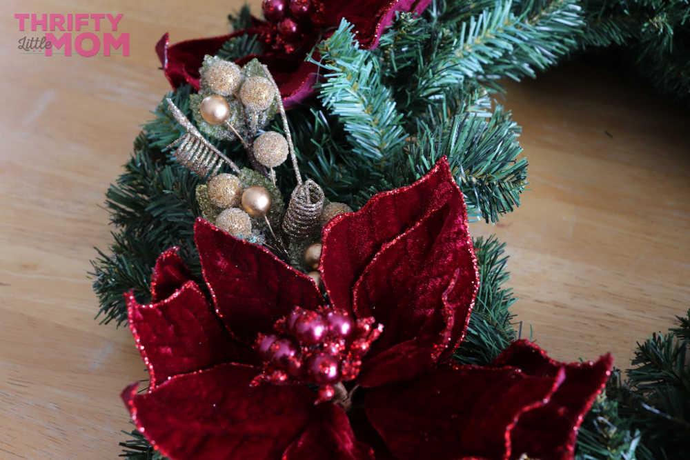 decorative items on poinsettia decor wreath