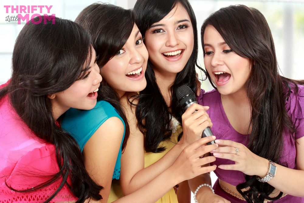 girls singing karaoke for a cheap birthday party idea