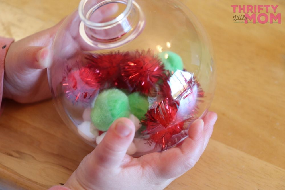 filling up the ornaments with pom poms