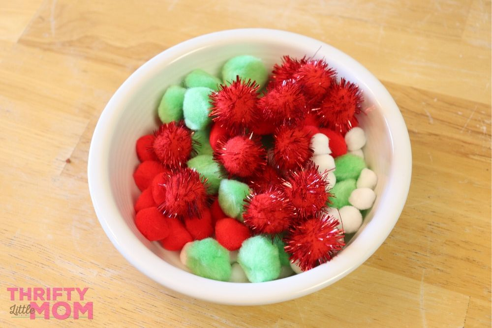 bowl full of pom poms