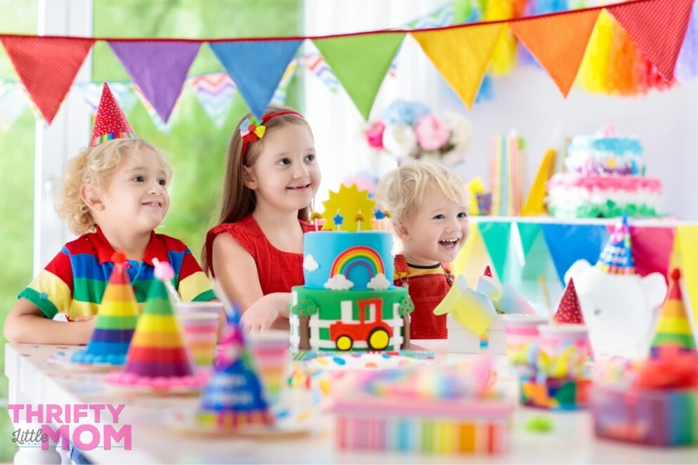 small children enjoying a rainbow party