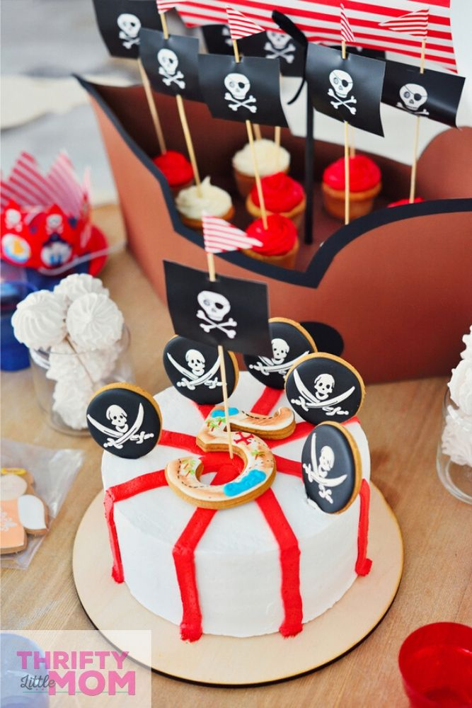 cake decorated with pirate party supplies