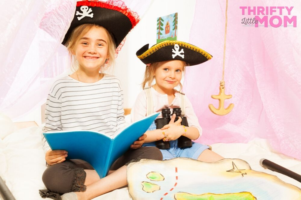 kids playing with pirate party supply treasure maps