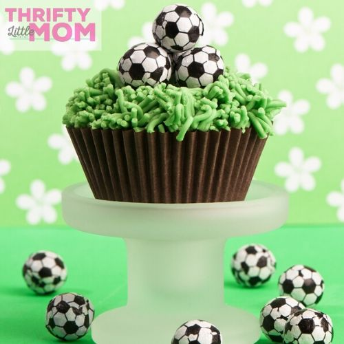 chocolate soccer balls on green cup cakes make delicious treats for birthday