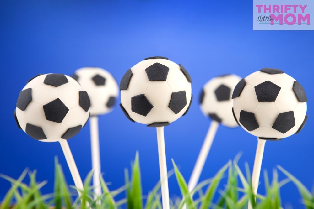 soccer ball cake pops make cute dessert at an 11 year old boy birthday party