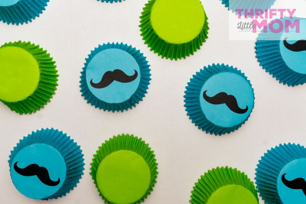 blue and green cupcake liners with mustaches for little man baby shower