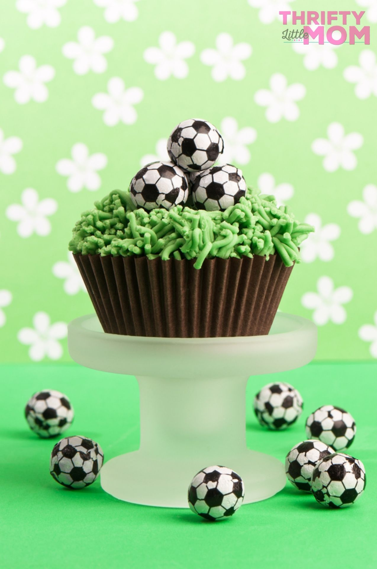 chocolate cupcake with grass and soccer ball decorations
