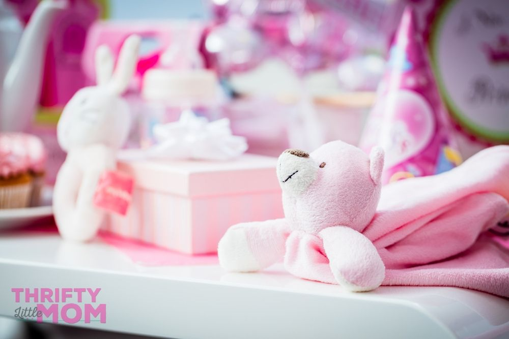 teddy bear baby shower gift table with toys