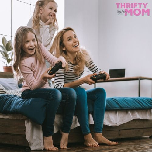 mom and daughters playing video games for mother's day