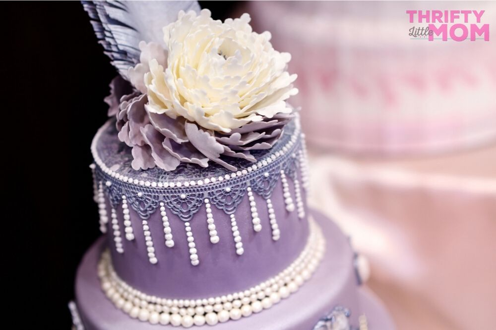 a cake that is decorated with jewelry embellishements for a lingerie party