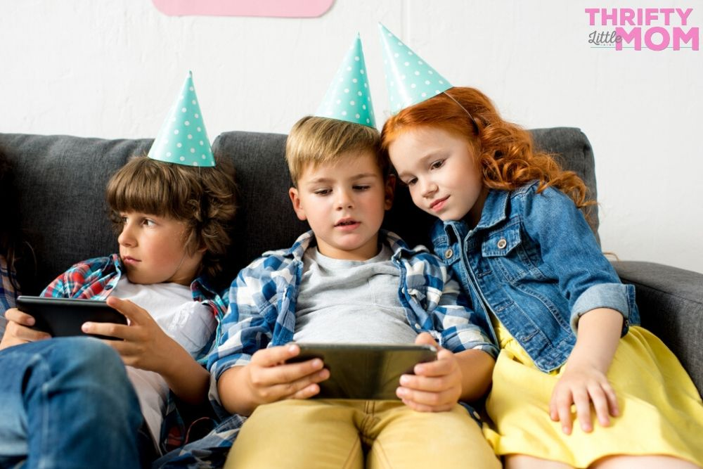 kids playing video games for an 8 year old birthday party idea