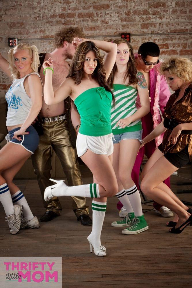 enjoy dancing to fun music at a disco party