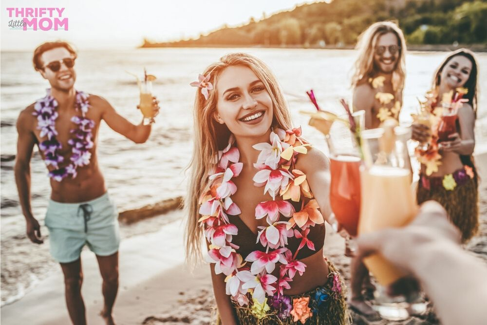 for luau party ideas, have friends gather on the beach in this adult party theme