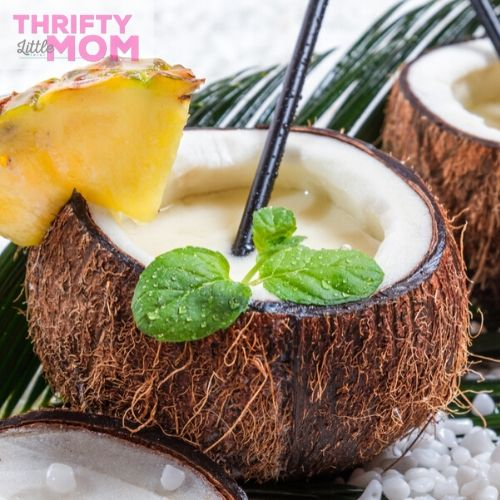 drink out of coconuts for a luau party idea